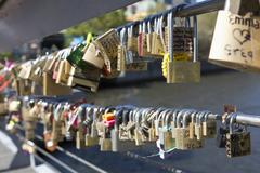 Large group of love padlocks on railing against lake Stock Photos