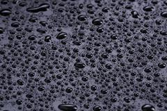 Water drops on hydrophobic plastic surface Stock Photos