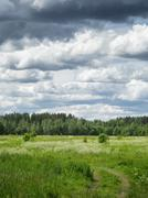 russian countryside landskape with cloudy sky - stock photo