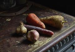 Root vegetables on wooden table Stock Photos