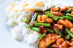 Fried stir chicken with red curry paste Stock Photos