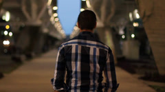 Man walking under a modern bridge Stock Footage