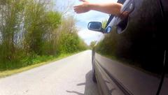 Driving black car pov with hand out of window timelapse. country road, trees Stock Footage