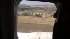 Airplane landing in Cyprus view from a passenger window Stock Footage