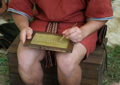 Young scribe writes on a wax tablet Stock Photos