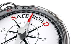 safe road conceptual compass - stock illustration