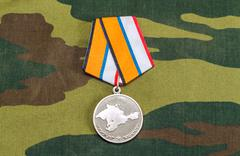 medal for the return of the crimea on camouflage background. award of the def - stock photo