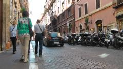 Tourist walk on the narrow streets of Rome Stock Footage