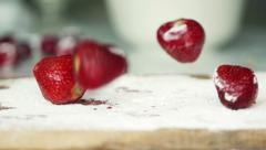 Strawberries falling on kitchen board, super slow motion, shot at 240fps HD Stock Footage