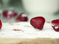 Strawberries falling on kitchen board NTSC Stock Footage