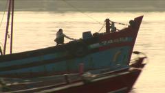 Big Asian Fishing Boat at Sunset - stock footage
