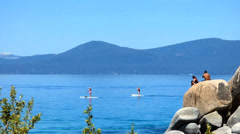 Swimmers, Kayaks and Paddle Boards Lake Tahoe Stock Footage