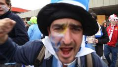 Uruguayan fan screaming in support of Luis Suarez in 2014 World Cup - stock footage