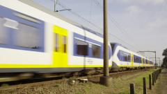 Dutch railway crossing with slow train passing by Stock Footage