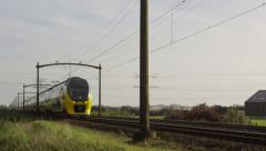 Dutch Intercity train is passing by at medium speed Stock Footage