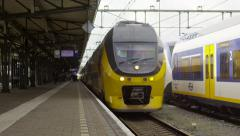 Dutch Intercity train departing the station Stock Footage