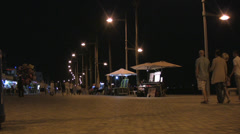 Paphos night scene with people walking Stock Footage
