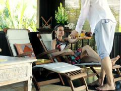 Couple drinking juice, relaxing on terrace in tropical place NTSC Stock Footage