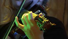 Closeup on an electric violin played by a wooman Stock Footage