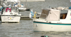 A boat with a finlad flag on it 4k fs700 odyssey 7q Stock Footage