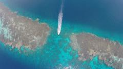 aerial shot of motorboat pass over coral reef gangway - Red sea, Shaab Rumi - stock footage