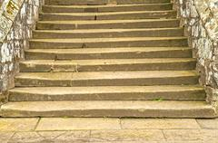 Old Rough Uneven Stone Staircase - stock photo