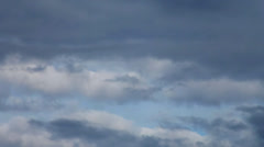 Amazing dramatic gloomy view of the disappearing blue sky in low leaden clouds. - stock footage