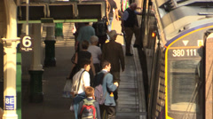 Students and traveler get on the train - stock footage