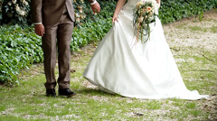 Wedding Couple walking in a park - stock footage