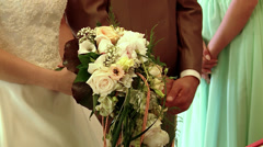 Grecian Wedding couple in a church, putting rings on finger Stock Footage