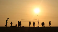 People playing Beachvolleyball in the sunset Stock Footage