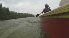 Rowers slowly navigating canoe Stock Footage