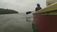 Rowers slowly navigating canoe - stock footage