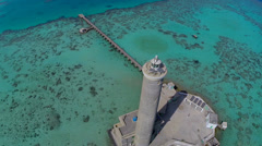 Aerial shot of lighthouse on coral reef - Sanganeb, Sudan, TWO CLIP IN ONE! Stock Footage
