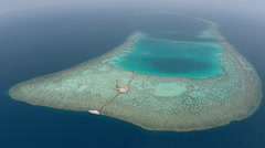 Aerial shot of lighthouse on coral reef - Sanganeb, Sudan Stock Footage