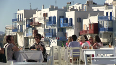 Tourists in tavern of Mykonos Island in Greece Stock Footage
