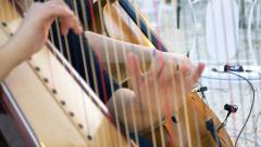 Hands strings harpist Stock Footage
