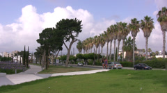 Main road with grass verge and pathway in Paphos Stock Footage