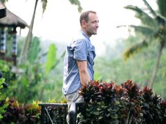 Young happy man relaxing on tropical forest  NTSC Stock Footage
