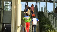 People Riding Up Escalator Stock Footage
