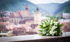 Wedding bouquet spring flowers with brasov city view panoramic Stock Photos