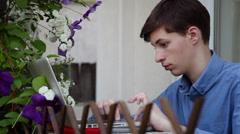 Study for exams in flower garden, preparing, working, school, laptop Stock Footage