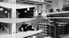People shopping their kitchenware with black and white toned Stock Footage