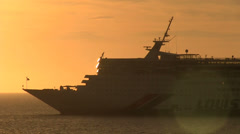 Ship underway at sunset, Stock Footage