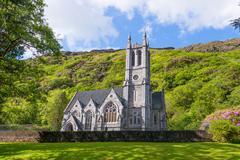 Historic Gothic Church on Green Hillside - stock photo