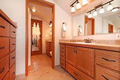 Bathroom interior in log cabin house Stock Photos