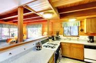 Stock Photo of kitchen interior in log cabin house