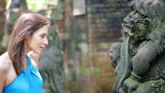 Young woman, tourist looking at beautiful ancient sculpture HD Stock Footage