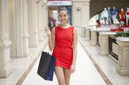 Stock Photo of young beautiful woman in red dress