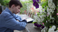 Young male student, teenager with tablet computer on home porch - stock footage